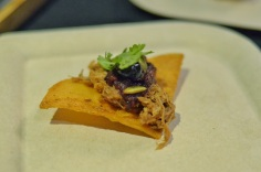 Braised pork on corn tortilla with saskatoon pepita salsa by Red Ox Inn